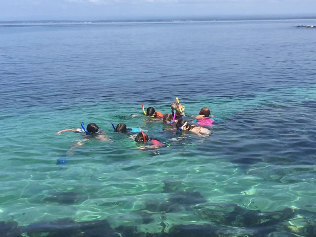 Kids snorkeling at camp